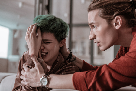 Calm down. Worried emotional husband calming down his crying wife with bleeding nose
