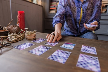 Prediction of future. Close up of tarot cards lying on the table while predicting the future