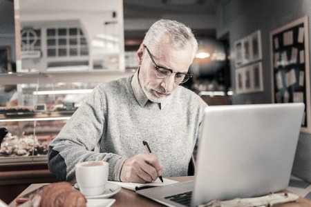 Concentrate on business. Professional manager working at computer while completing task
