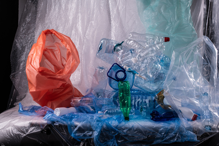Colors and textures. Unpleasant installation with used water bottles and bags and litters showed on camera Reklamní fotografie
