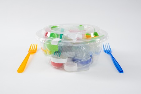 Literal meal. Harmful pile of plastic trash and pieces placed inside of transparent container as installation of polluted environment