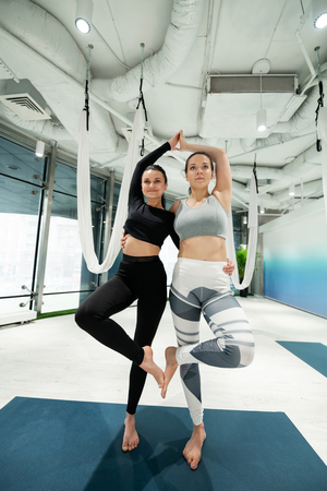Satisfied women. Slim and fit women feeling satisfied after practicing yoga together