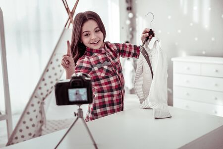 This is fashion. Pleasant cute girl recording a new video while having a fashion blog Imagens