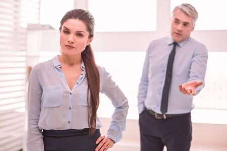 Self-confidence. Woman feels confident irrespectively to the colleagues opinion