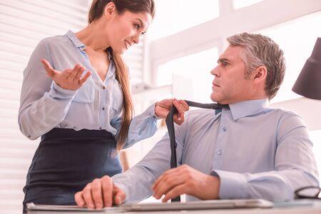 Informal relations. Man and woman flirting at work