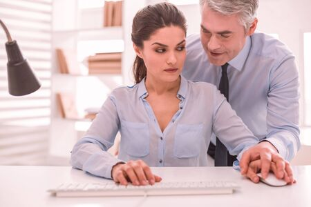 Gender inequality. Male boss obscenely communicating with his female colleague
