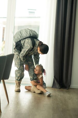 Do not go. Emotional loving daughter not letting go mother serving in armed forces