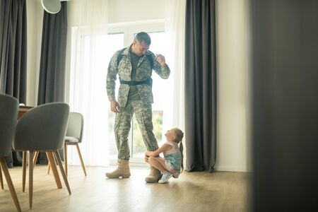 Coming back soon. Loving serviceman calming his cute daughter down while coming back soon Banco de Imagens