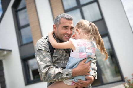 Cute girl crying. Cute girl crying after seeing her father returning home from military service