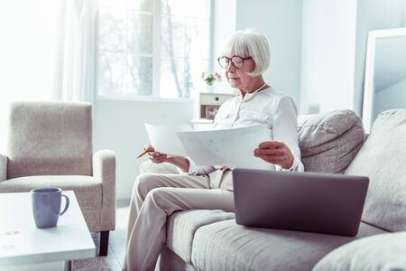 Work from home. Busy hard-working elderly businesswoman feeling involved in working from home