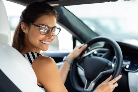 Feeling excited. Beautiful happy businesswoman feeling excited in the morning while driving to work Stock Photo