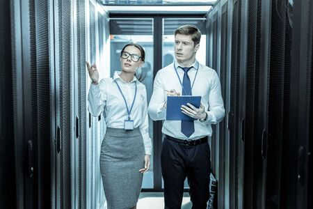 Wire-tapping. Two professionals from an intelligence agency looking busy while working with wire-tapping Banco de Imagens