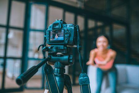 Modern black camera. Close up of modern black camera filming fitness blogger Archivio Fotografico - 133528116