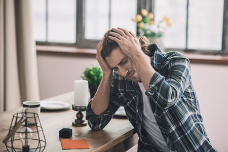 Big failure. Man feeling stressed and frustrated having his proposal rejected Stock Photo
