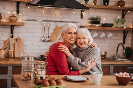 Women. Two mature grey-haired positive ladies feeling great together Foto de archivo
