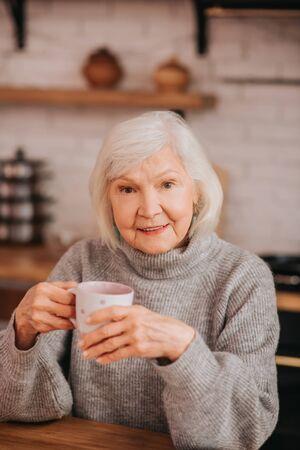 Beautiful lady. Beautiful elderly woman in grey sweater looking good