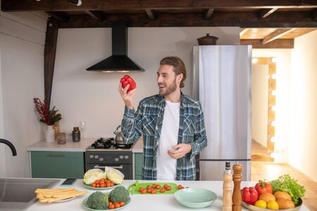 Healthy food. A man making a healthy salad in his kitchen