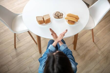 No carbs. A woman refusing to eat bread, buns and cookies