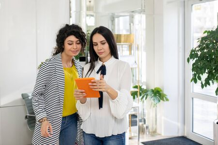 Consulting. Beauty consultant showing new beauty products in online catalogue