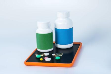 Buying online. Two different bottles of vitamins on the smartphone