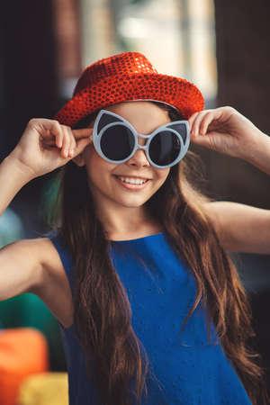 Posing. Pretty girl in eyeglasses posing for the photo