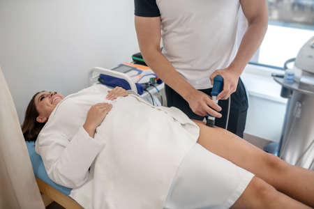 Examination. A doctor examining a woman with a specific apparatus Stockfoto