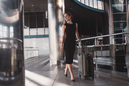 Confident traveller. A confident young woman having a business trip 免版税图像