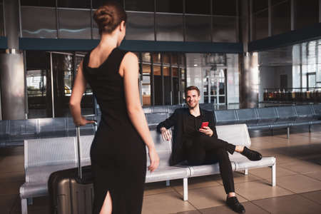 Important meeting. Man waiting for a woman in the airport