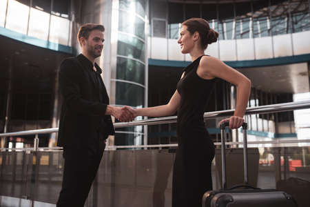 Women in business. Male and female business partners shaking each others hands