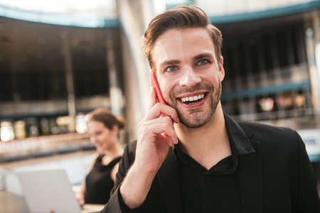 Effective communication. A joyful handsome man making a business phone call