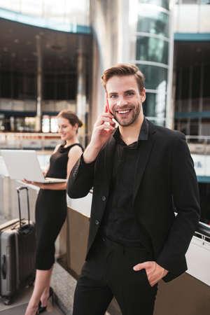 Business communication. A confident handsome man making a phone call 免版税图像