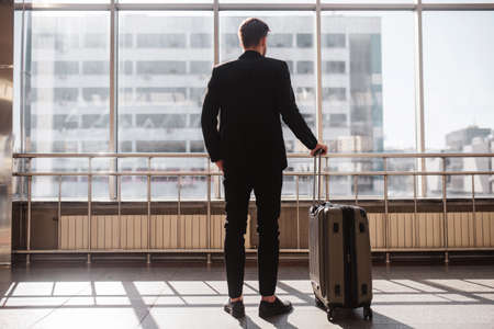 Business trip. A man preparing to depart from the airport 版權商用圖片