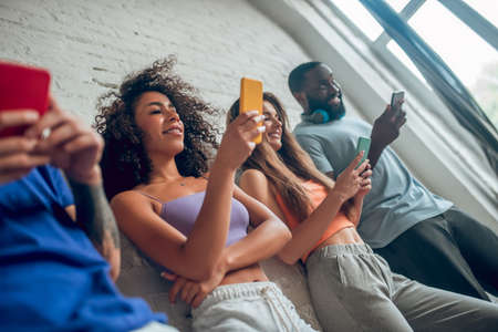 Modern communication. Three people scrolling their social media accounts Reklamní fotografie