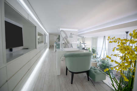 Cosmetological parlor. Modern stylish cosmetological parlor in large light beauty center with latest equipment and comfortable furniture Foto de archivo