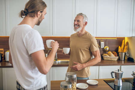 Morning at home. Same-sex couple having breakfast together at home and feeling good