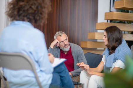 Family psychologist. A man and woman visiting a family psychologist together
