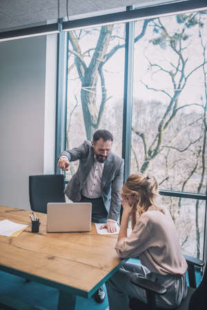Angry screaming boss firing woman assistant
