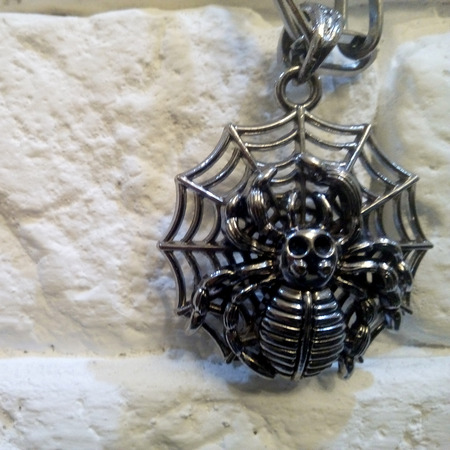 Halloween themed decoration in the form of a spider on the web