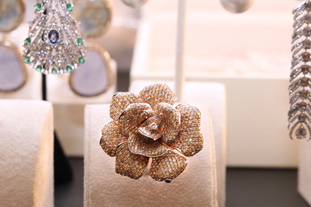 Gorgeous expensive ring in the form of a flower with diamonds