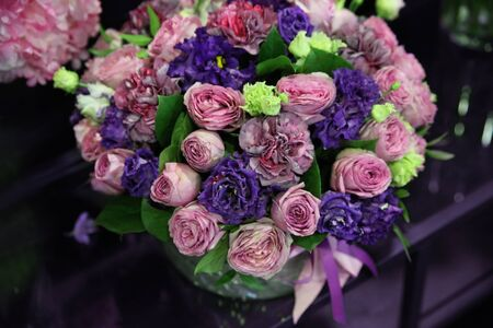 Huge beautiful bouquet with purple roses, blue eustoma and carnations