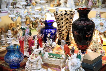 Large crystal colored vases, beautiful figurines at the flea market