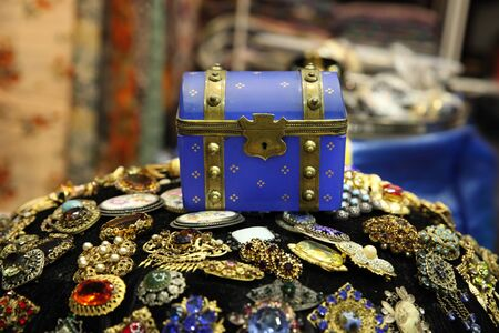 Vintage small blue chest and lots of colorful jewelry