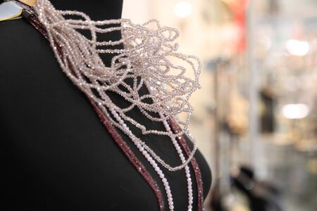 Mannequin with a sparkling bead necklace on the unfocused background of a jewelry store Stock fotó - 150294281
