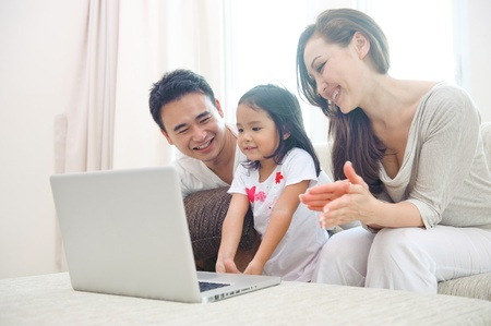 happy asian family: Happy Asian Family using laptop with daugther