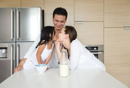 having breakfast: Happy Asian Family having breakfast together in the morning Stock Photo