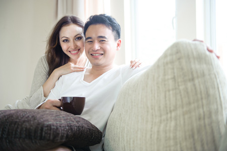Couple Happy relaxing drinking coffee photo