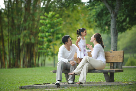 family park: Happy Asian Family enjoying their time in the park
