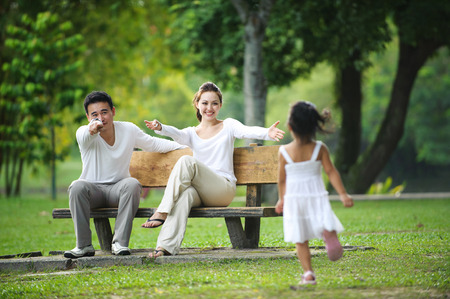 asian men: Happy Asian Family enjoying their time in the park