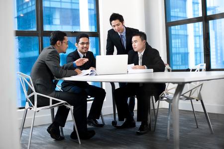 asian businessman: Asian businessman working on laptop