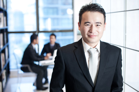 asian businessman: Asian business man smiling